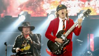 Axl Rose and Angus Young onstage