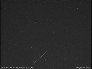 An Orionid meteor streaks across the night sky over Huntsville, Ala., in this view from a camera at NASA's Marshall Space Flight Center before dawn on Oct. 21, 2012