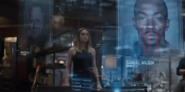 Captain Marvel looking at the fallen