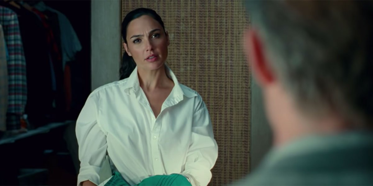 Wonder Woman looking at Steve Trevor while dressed in a white button up shirt.