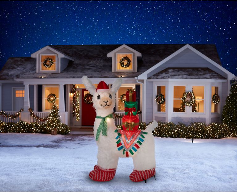 7-ft Lighted Llama Christmas Inflatable against house background