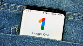Google One app on a phone in a jeans pocket