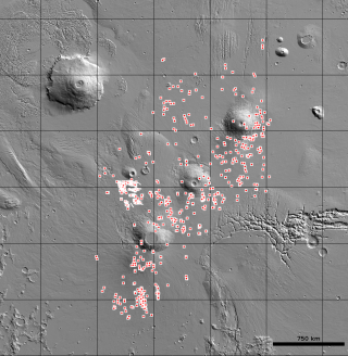 The U.S. Geological Survey's (USGS) Astrogeology Science Center has released the locations of more than 1,000 cave-entrance candidates on Mars. The dots indicate the location of possible caves in the Tharsis region on Mars.