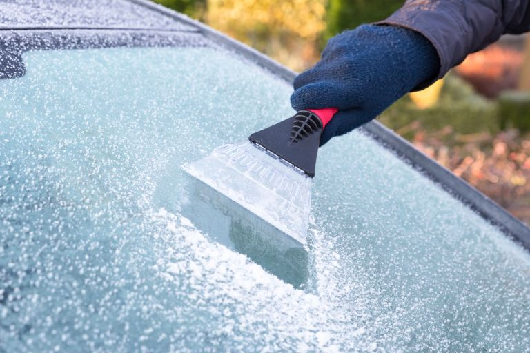 how to de-ice a car by scraping the car windscreen