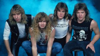 Megadeth lined up in front of a blue background