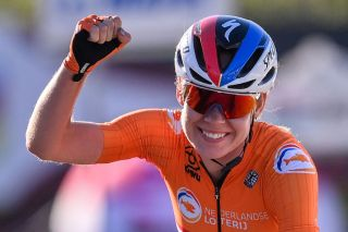 Netherlands Anna van der Breggen celebrates as she crosses the finish line to win the Womens Elite Road Race a 143kilometer route around Imola EmiliaRomagna Italy on September 26 2020 as part of the UCI 2020 Road World Championships Photo by Marco BERTORELLO AFP Photo by MARCO BERTORELLOAFP via Getty Images