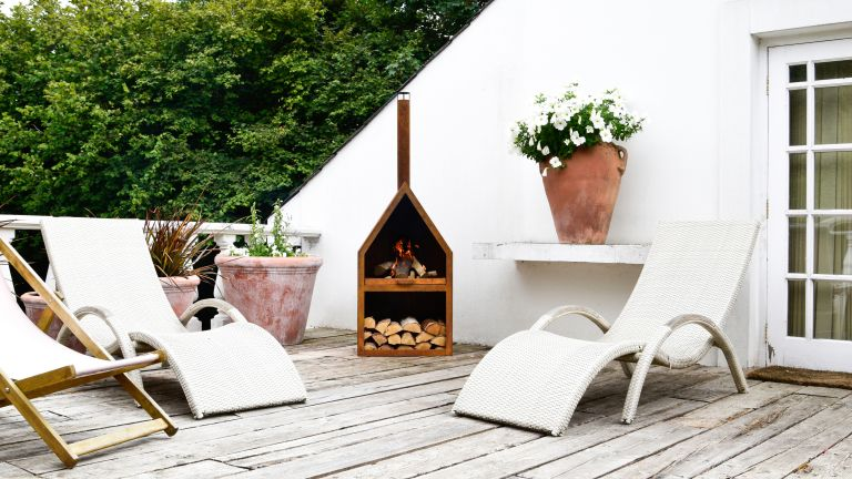 Roof terrace with fire pit as outdoor heating idea