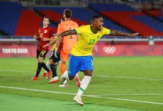 Malcom celebrating his goal against Spain