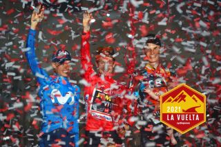 Team Jumbo's Slovenian rider Primoz Roglic (C) celebrates winning the 2021 La Vuelta cycling tour of Spain flanked by Team Movistar's Spanish rider Enric Mas (L) and Team Bahrain's Australian rider Jack Haig after the 21st and final stage, a 33.8 km time-trial from Padron to Santiago de Compostela, on September 5, 2021. (Photo by MIGUEL RIOPA / AFP) (Photo by MIGUEL RIOPA/AFP via Getty Images)