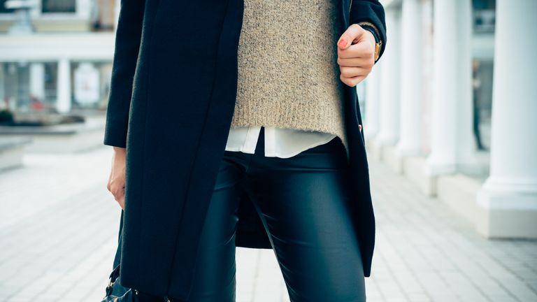 types of leggings: woman wearing faux leather leggings
