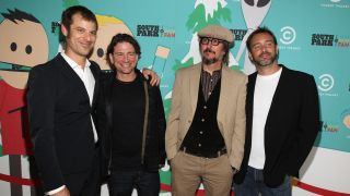 A picture of Primus' Larry LaLonde and Les Claypool with South Park creators Matt Stone and Trey Parker