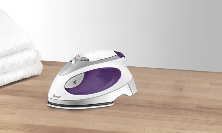 Best iron: Swan SI3070N on wood surface