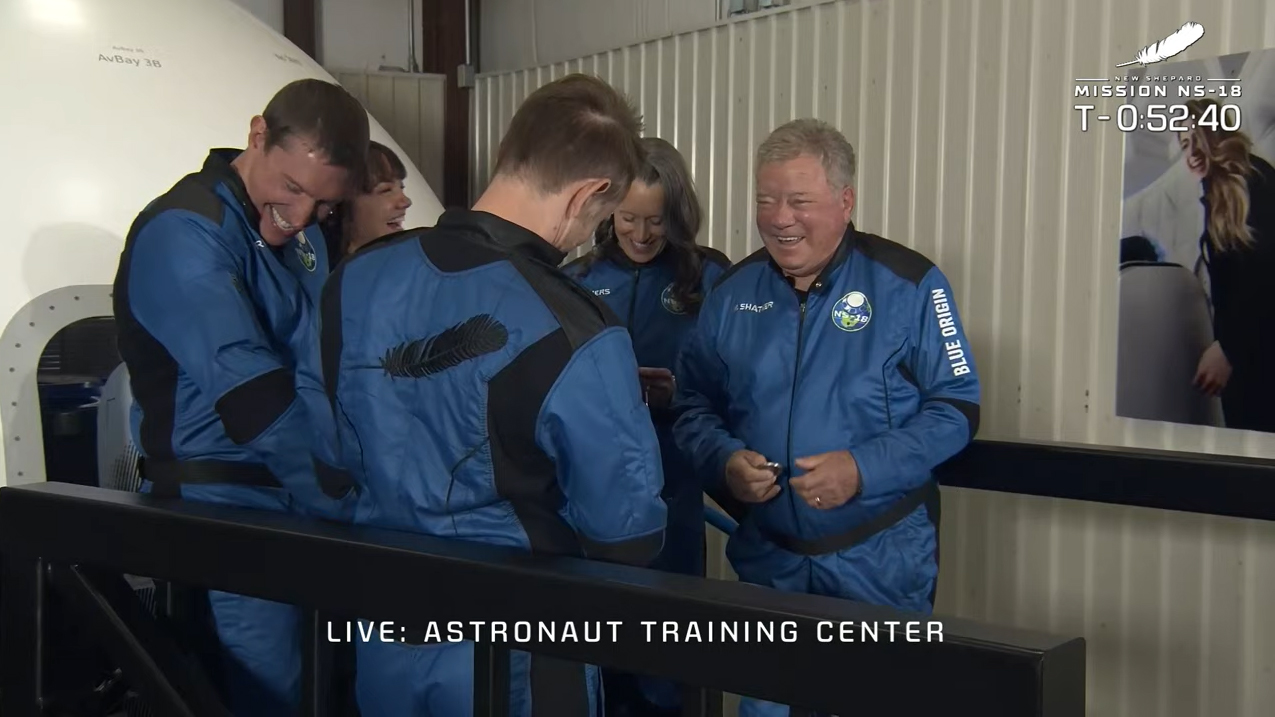 Blue Origin's NS-18 crew, including William Shatner, heads out to the launchpad for their launch into space on Oct. 13, 2021.