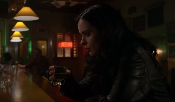 Marvel's Jessica Jones Jessica sits somberly at the bar with a shot in her hand