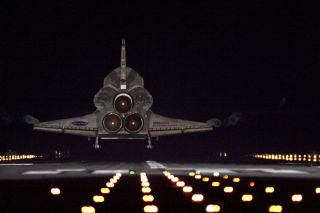 Runway lights help lead space shuttle Endeavour, seen here from behind, home to NASA's Kennedy Space Center in Florida. Endeavour landed for the final time on the Shuttle Landing Facility's Runway 15, on June 1, 2011, marking the 24th night landing of NAS