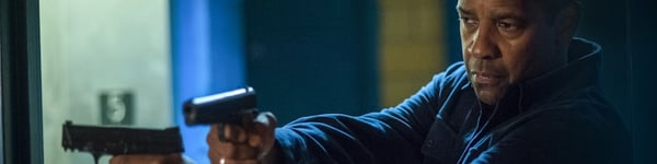 Robert McCall (Denzel Washington) holding two guns in The Equalizer 2
