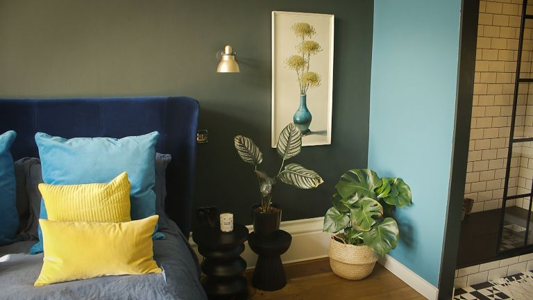 green bedroom with blue wall and yellow accents