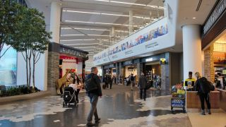 Dante-compliant solutions from AtlasIED provide innovative paging, emergency notification, messaging, and boarding information throughout airport terminals and concourses at New York City's LaGuardia Airport. Shown, LaGuardia Terminal B.