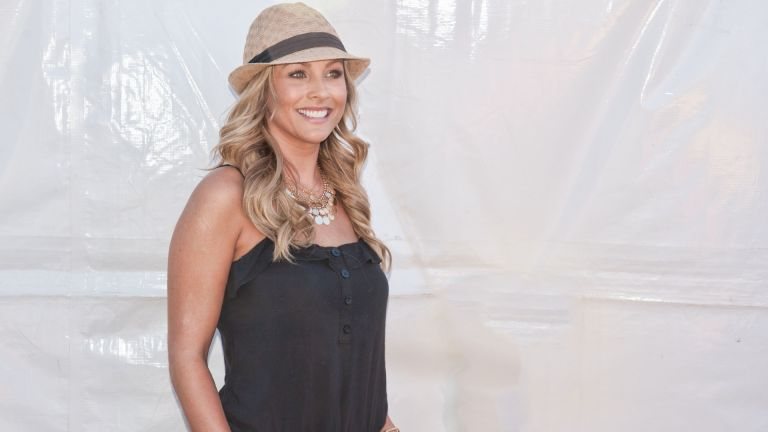 Finalist Clare Crawley from reality TV show the Bachelor posing backstage at 107.9's EndFest