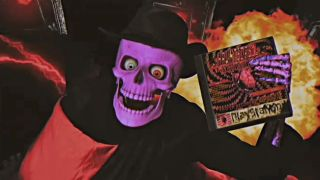 A skeleton holding a PlayStation game spookily