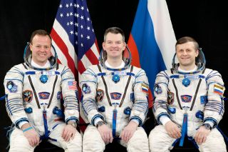 NASA astronaut Ron Garan (left) and Russian cosmonauts Alexander Samokutyaevn (center) and Andrey Borisenko post for a crew photo while clad in Russian Sokol spacesuits.The crew will launch on the Soyuz TMA-21 spacecraft to visit the International Space S