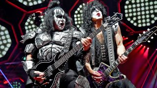 Kiss members Gene Simmons and Paul Stanley perform in the band's trademark costumes and makeup.