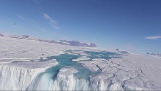 Seen from an aircraft, a 400-foot-wide (120 meters) waterfall drains off Antarctica's Nansen Ice Shelf into the ocean.