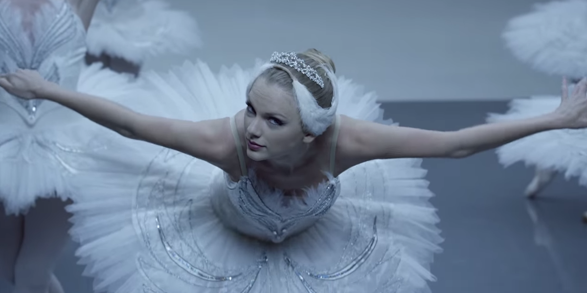 Taylor Swift in a ballerina outfit bowing in Shake it Off music video