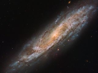 The Hubble Space Telescope spotted the galaxy NGC 2770 in this close-up view. The galaxy has been home to four different observed supernovae over the years, making it unusual and especially interesting to scientists studying the far-out cosmos. One of the supernovae spotted in the galaxy, SN 2015bh, was first thought to possibly not be a supernova but rather a strange outburst from an old, massive star. However, it was later correctly classified as a supernova created when a star 8-50 times as massive as our sun died.