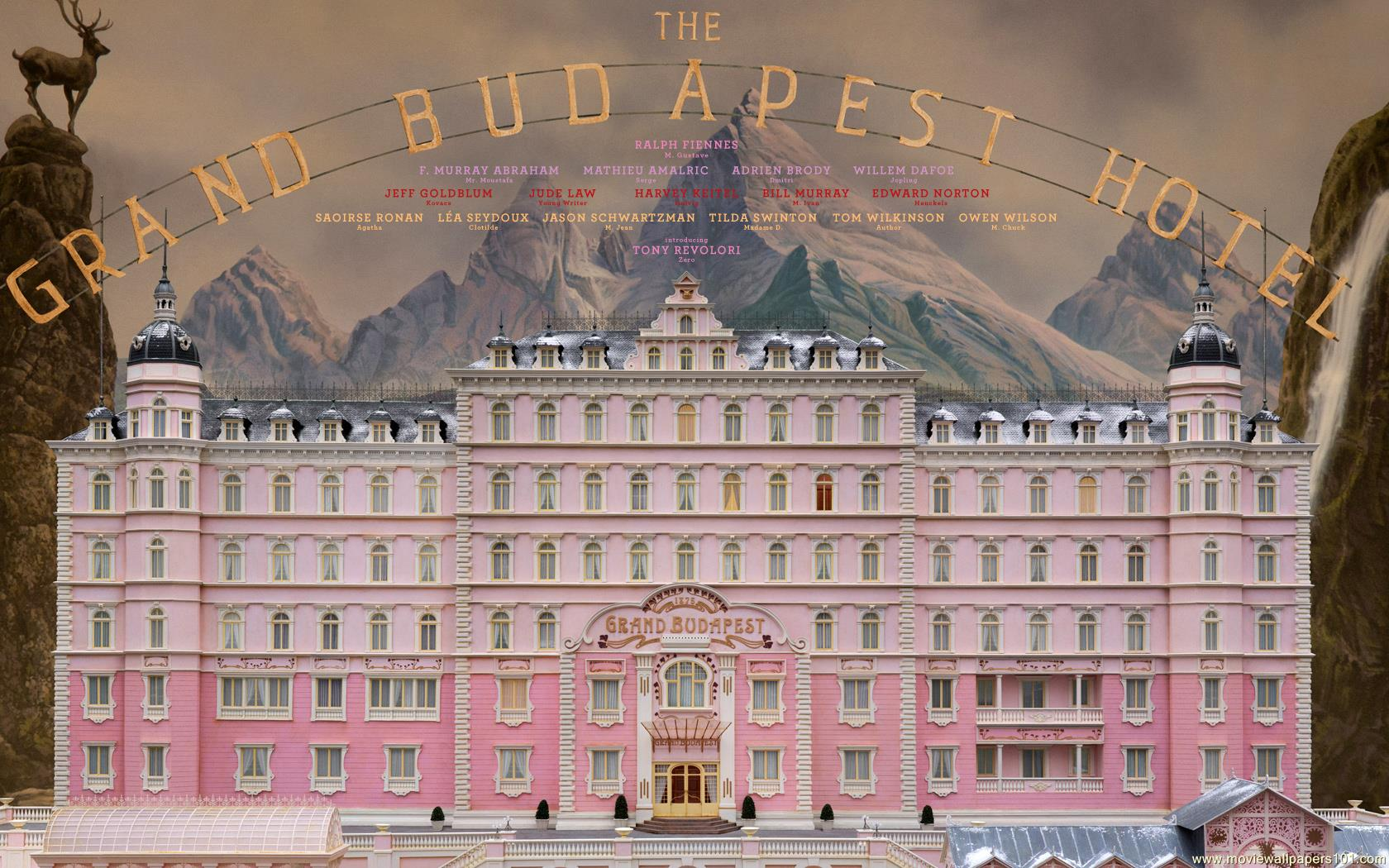 Front of the pink Grand Budapest Hotel with mountain backdrop and title from the film