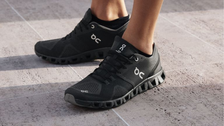 On Cloud X shoe review: a model wears a black pair of the workout shoes