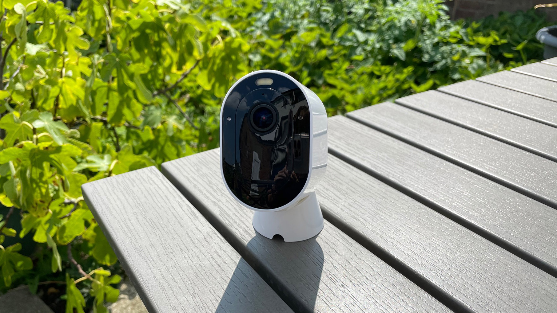 Arlo Pro 4 on its magnetic mount table in the garden