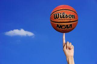 Wilson Basketball balances on one finger