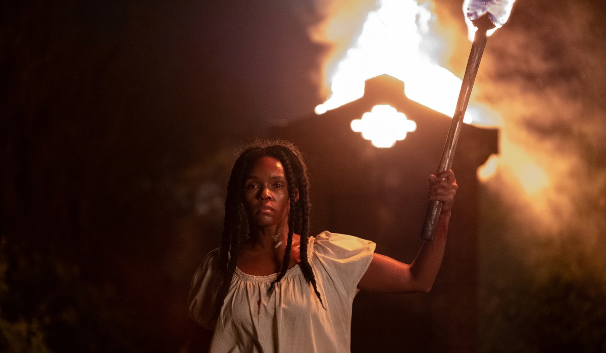 Antebellum Veronica marches with a torch in her hands