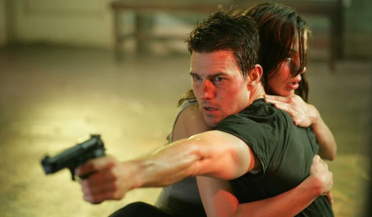 Tom Cruise holds Michelle Monaghan, while aiming a gun, in Mission: Impossible III