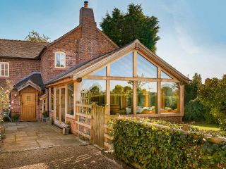 an oak frame extension on a traditional home