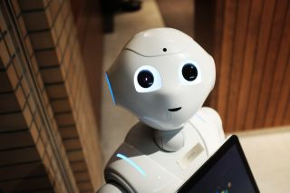 Humanoid robot looks up with smiling expression
