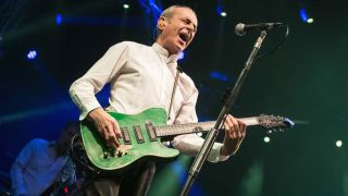 A shot of Francis Rossi on stage