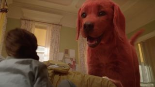Clifford the Big Red Dog looking down at little girl