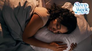 What's the best color smart lighting for sleep? Image shows woman sleeping in bed
