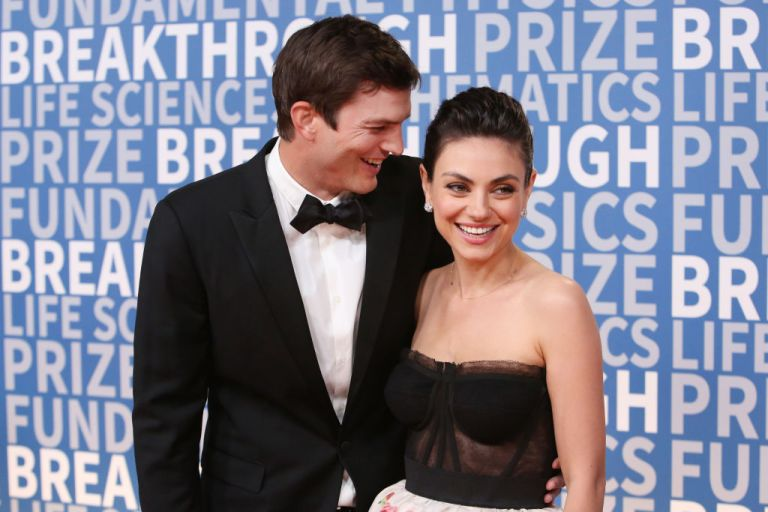 Actors Ashton Kutcher (L) and Mila Kunis attend the 2018 Breakthrough Prize at NASA Ames Research Center on December 3, 2017