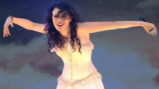 Sharon den Adel of Within Temptation onstage with her arms outstretched