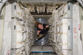 Astronaut Sandy Magnus and space station supplies