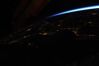 """Europe's city lights gleam through clear skies in this post-sunset photo by Canadian Space Agency astronaut David Saint-Jacques. """"Cloudless night over Spain and Southern France. I imagine people dining outside,"""" Saint-Jacques tweeted from the International Space Station."""