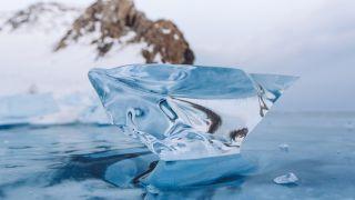 Transparent ice block on Lake Baikal on Olkhon island, Siberia, Russia, winter 2018.