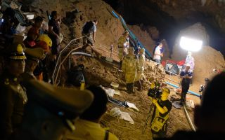 Thai officers supervise the rescue mission inside Tham Luang Nang Non cave on June 28, 2018 in Chiang Rai, Thailand. Twelve boys and their soccer coach have been trapped in the cave for nearly two weeks and rescue workers are working to get them out of th