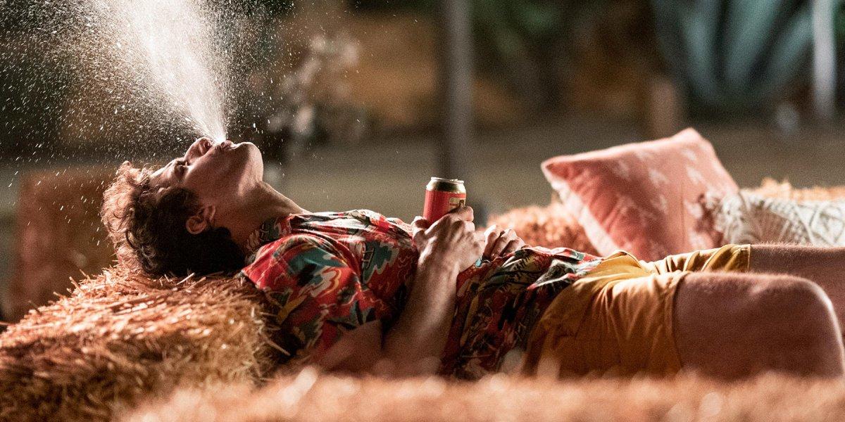 Palm Springs Andy Samberg spitting beer