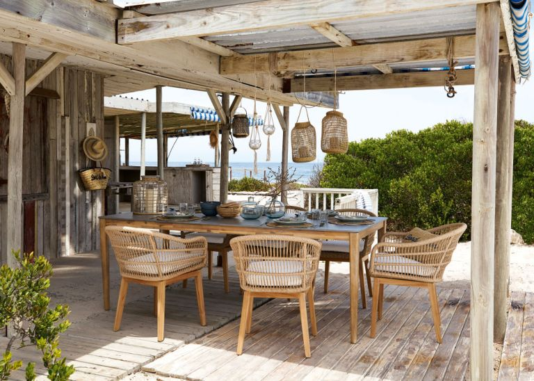 Best patio cleaners: Outdoor dining are with rattan chairs by Maisons du Monde