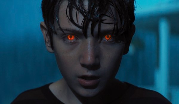 Brightburn Brandon's eyes glowing in the middle of a rainstorm