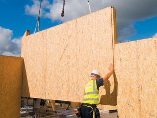 Structural insulated panels being installed on a site by a builder
